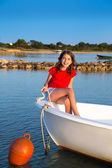 Kid girl pretending to be sailor in boat bow at Formentera — Stock Photo