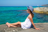 Girl looking at beach in Formentera turquoise Mediterranean — Stock Photo