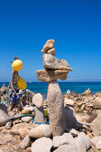 Stone figures on beach shore of Illetes beach in Formentera — Stock Photo