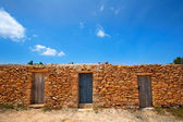 Formentera Cala Saona beach masonry fishermen houses — Stock Photo
