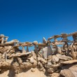 Stone figures on beach shore of Illetes beach in Formentera — Foto de Stock