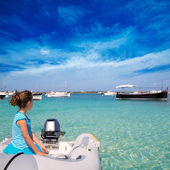 Kid girl in boat at formentera Estany des Peix — Stock Photo