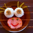 Funny kid food with rice and meat smiley face — Stock fotografie