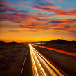 Arizona sunset at Freeway 40 with cars light traces — Stock Photo