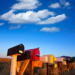 Grunge mail boxes in a row at Arizona desert — Stock Photo