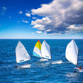 Sailboats Optimist learning to sail in Mediterranean at Denia — Stock Photo