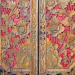 Indian inspired carved golden red wooden door — Stock Photo