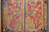 Indian inspired carved golden red wooden door — Stock Photo