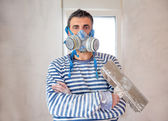 Funny plastering man mason with protective mask and trowel — Foto Stock