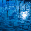 Stock Photo: Blue water reflection of sailboats boats poles in waves