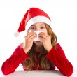 Christmas Santa kid girl blowing her nose in a winter cold — Stock Photo #37122259