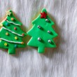 Christmas cookies Xmas tree shape on white fur — Stock Photo