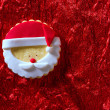 Christmas cookies Santa face on red background — Stock Photo #37124651