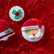 Christmas cookies Santa face and Xmas bell on red background — Stock Photo #37125457
