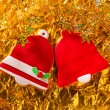 Christmas cookies Xmas red bell shape on golden — Stock Photo
