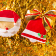 Christmas cookies Xmas red bell ribbon and Santa on golden — Stock Photo