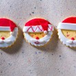 Christmas cookies with santa face on recycled paper — Stock Photo