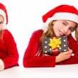 Christmas Santa kid sister girls happy excited with ribbon gifts — Stock Photo
