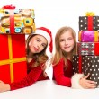 Christmas Santa kid girls with many gifts stacked — Stock Photo