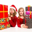 Christmas Santa kid girls with many gifts stacked — Stock Photo #37128395