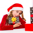 Christmas Santa kid girl happy excited with ribbon gifts — Stock Photo #37129061