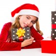Christmas Santa kid girl happy excited with ribbon gifts — Stock Photo