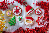 Christmas cookies Xmas tree Santa snowflake on white fur — Stock Photo