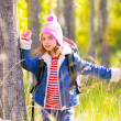 Stock Photo: Hiking kid girl with backpack in autum poplar forest