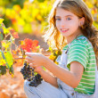 Kid girl smiling autumn vineyard field holding grapes bunch — Stock Photo