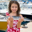 Stock Photo: Happy kid fisherwomwith barracudfish catch