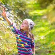 Stock Photo: Kid winter girl picking mulberry berries in forest