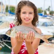 Stock Photo: Happy kid fisherwomwith dentex fish catch