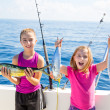 Happy tuna fisherwomen kid girls with fishes catch — Stock Photo #37654753