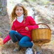 Stock Photo: Kid girl searching chanterelles mushrooms with basket in autumn