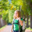 Blond explorer kid girl walking with backpack in autumn trees — Stock Photo #37655507