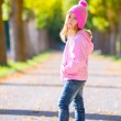 Autumn winter kid girl blond with jeans and pink snow cap — Stock Photo #37656081