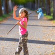 Stock Photo: Little kid with hobo stick bag and bundle girl saying goodbye