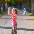Little kid with hobo stick bag and bundle girl saying goodbye — Stock Photo