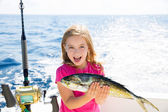 Blond kid girl fishing Dorado Mahi-mahi fish happy catch — Stock Photo