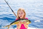 Blond kid girl fishing Dorado Mahi-mahi fish happy catch — Stock Photo