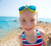 Kid funny girl wide angle beach portrait swimsuit and goggles — Stock Photo