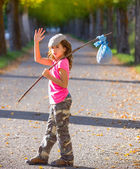 Little kid with hobo stick bag and bundle girl saying goodbye — Stock Photo