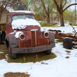 Snow old truck in early spring time in Nevada — Stock Photo #37661143