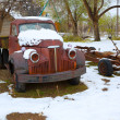 Snow old truck in the early spring time in Nevada — Stock Photo #37661143
