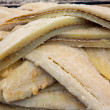 Stock Photo: Cod fish salted codfish in a row stacked