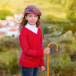 Kid girl shepherdess with wooden baston in Spain village — Stock Photo
