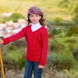 Stock Photo: Kid girl shepherdess with wooden baston in Spain village