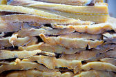 Cod fish salted codfish in a row stacked — Stok fotoğraf
