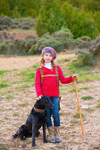 Kid girl shepherdess happy with dog and flock of sheep — Stock Photo