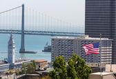 San Francisco USA American Flag Bay Bridge and Clock tower — ストック写真